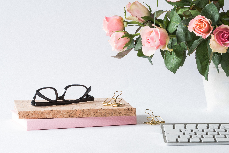 eyeglasses-on-book-beside-rose-and-keyboard-2008143